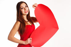 Beautiful girl in red bodi holding paper heart. Pretty teenager blonde girl is wearing red bodi holding red paper hearts over white background, valentines day Stock Photo