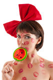 Beautiful girl with a red bow and lollipop in mouth in lipstick kisses Stock Images