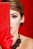 Beautiful girl with a red clutch bag Stock Images