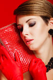 Beautiful girl with a red clutch bag Stock Image