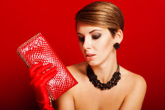 Beautiful girl with a red clutch bag Stock Photography