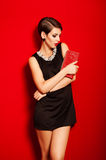 Beautiful girl with a red clutch bag Royalty Free Stock Photos