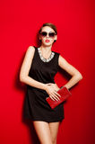Beautiful girl with a red clutch bag in her hands Royalty Free Stock Photo