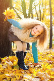 Beautiful Girl with Red Curly Hair in the Autumn Park Stock Image