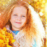 Beautiful Girl with Red Curly Hair in the Autumn Park Royalty Free Stock Image