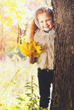 Beautiful Girl with Red Curly Hair in the Autumn Park Stock Photo