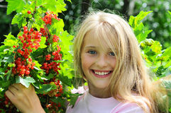 Beautiful girl with red currant Royalty Free Stock Images