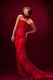 Beautiful girl in red dress Stock Images