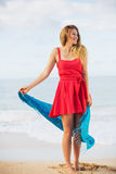 Beautiful Girl in Red Dress on The Beach Royalty Free Stock Image