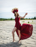 Beautiful girl in a red dress on the beach. Concept of femininity, harmony Royalty Free Stock Images