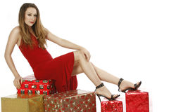 Beautiful girl red dress christmas presents Royalty Free Stock Photo