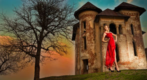 Beautiful girl in red dress on the field Stock Photography