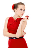 Beautiful the girl in red dress holding a Apple Royalty Free Stock Photo