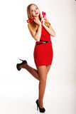 Beautiful girl in red dress holding hearts Royalty Free Stock Photography