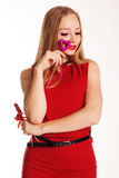 Beautiful girl in red dress holding hearts Royalty Free Stock Photo