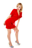 Beautiful girl in a red dress posing. Isolated on white background royalty free stock image