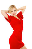 Beautiful girl in a red dress posing. Isolated on white background stock photography