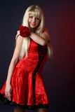 Beautiful girl in red dress with red rose Royalty Free Stock Photography
