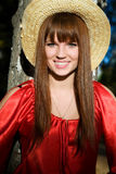 Beautiful girl in a red dress and a straw hat Royalty Free Stock Photos
