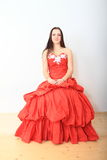 Beautiful girl in red evening dress Stock Images