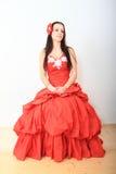 Beautiful girl in red evening dress Stock Photos