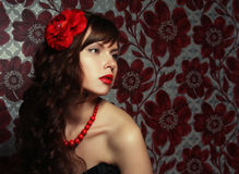 beautiful girl with red flower in hair Stock Photos