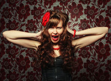Beautiful girl with red flower in hair Stock Image
