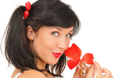 Beautiful girl with red flower looking at camera Stock Photography