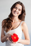 Beautiful girl with red flower Stock Image
