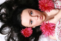 Beautiful girl in red flowers Royalty Free Stock Photos