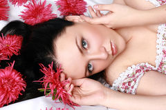 Beautiful girl in red flowers Stock Photo