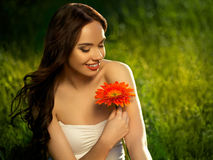Beautiful Girl With Red Flowers. Beautiful Model Woman Face. Royalty Free Stock Photos