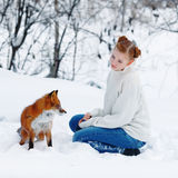 Beautiful girl with red fox on walk Stock Photography