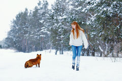 Beautiful girl with red fox on walk Royalty Free Stock Photo