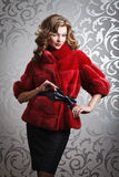 Beautiful girl in red fur coat. Pretty young lady in red mink fur coat Stock Images