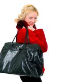 Beautiful girl in a red fur coat with stylish bag Royalty Free Stock Photography