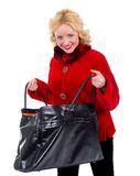 Beautiful girl in a red fur coat with stylish bag Royalty Free Stock Photo