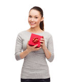 Beautiful girl with red gift box Stock Image