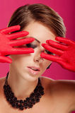 Beautiful girl in red gloves Royalty Free Stock Image
