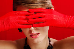 Beautiful girl in red gloves Stock Photography