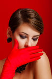 Beautiful girl in red gloves Stock Images