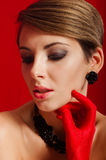 Beautiful girl in red gloves Royalty Free Stock Images