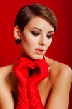 Beautiful girl in red gloves Stock Image