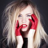 Beautiful girl with red gloves and red lips Royalty Free Stock Images