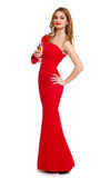 Beautiful girl in red gown with champagne isolated on white background, winter holiday concept Royalty Free Stock Photo
