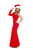 Beautiful girl in red gown and santa hat isolated on white background, winter holiday concept Royalty Free Stock Photography