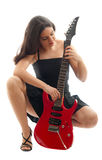 Beautiful girl with red guitar on white Royalty Free Stock Images