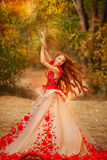 Beautiful girl with red hair in autumn park royalty free stock image