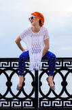 The beautiful girl with red hair and points, in style of 60 year. S, Fashion. Model Royalty Free Stock Photo