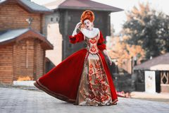 Beautiful girl with red hair. Red Queen in the castle. Red-haired woman in a chic vintage dress. Fashion Photo royalty free stock photo